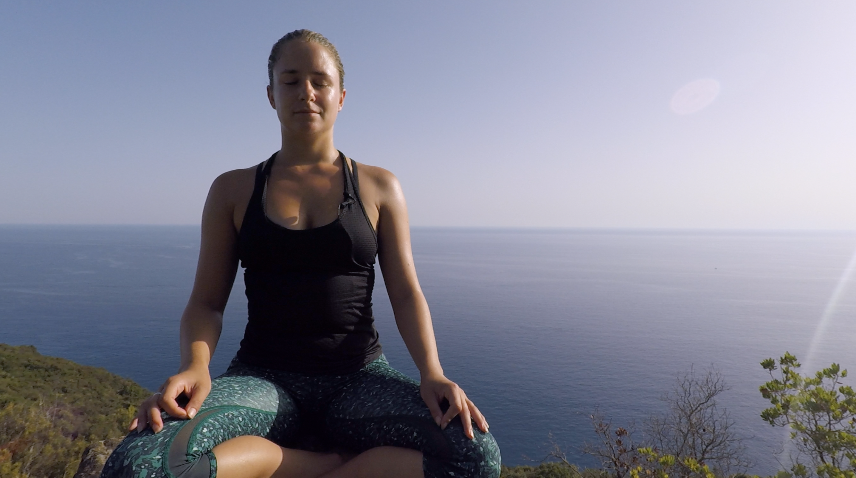 Woman meditating on a mountain in Italy