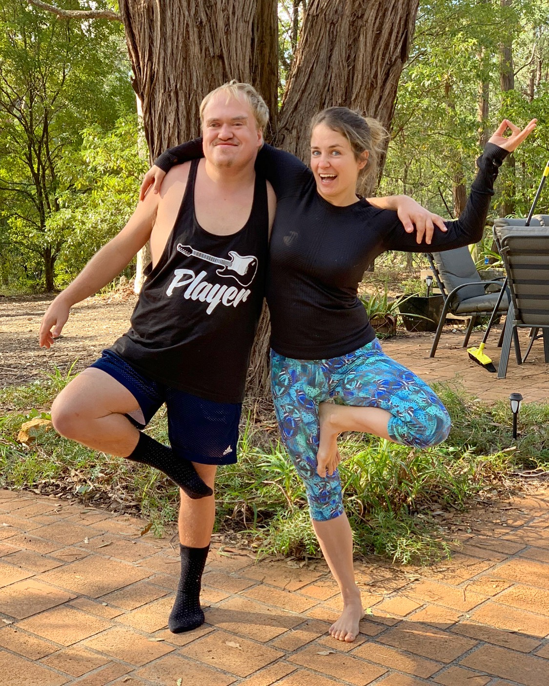 A man and a woman doing yoga together