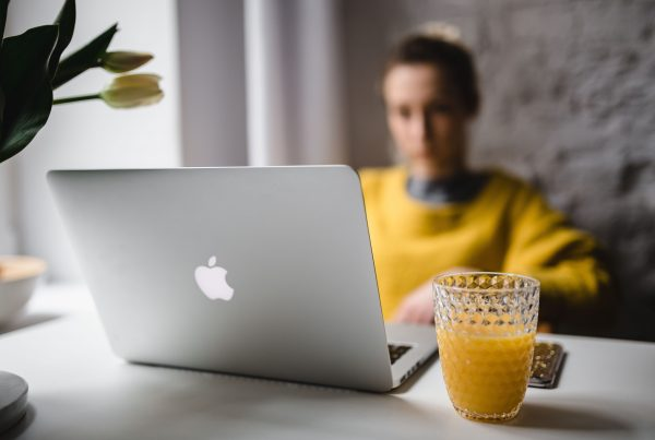 Woman busy doing work on her computer
