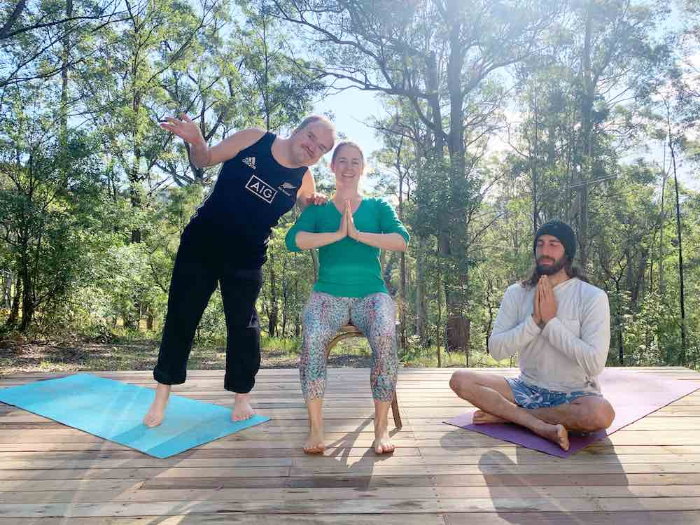 3 people of different abilities doing inclusive yoga and dance